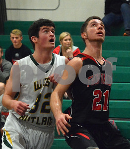 Photo by Albert J. Marro   West Rutland's Bryan Maxham (32) and  Twin Valley'sSkyler Boyd (21) look up for rebound position during Saturday's game in Westside. Twin Valley pulled away in the fourth quarter and won 60-42. Boyd had 30 points for the Wildcats.