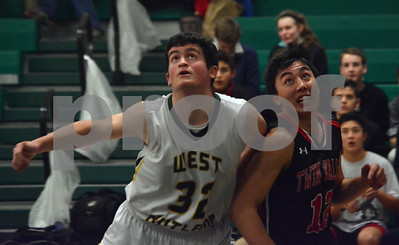 Photo by Albert J. Marro   West Rutland's Bryan Maxham (32) and Twin Valley's Logan Park (12) battle for position during Saturday's game in Westside. Twin Valley pulled away in the fourth quarter and won 60-42.