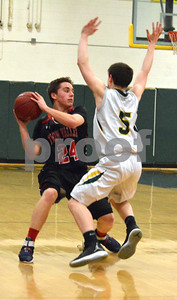 Photo by Albert J. Marro   West Rutland's Jacob Dow (5) stops the drive of Twin valley's  Brett Swanson (24) during Saturday's game in Westside. Twin Valley pulled away in the fourth quarter and won 60-42.