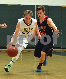 Photo by Albert J. Marro   West Rutland's Francis Grabowski (21) charges up court past Twin Valley's Dylan Howe (15) during Saturday's game in Westside. Twin Valley pulled away in the fourth quarter and won 60-42.