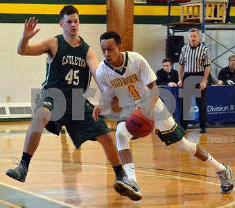 Photo by Albert J. Marro   Green Mounatin's Darius Wynn (4) get a step on Castleton's Ben Mrowka (45) and drives down the lane  during Saturday's game in Poultney. GMC won 80-68