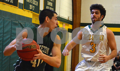 Photo by Albert J. Marro   Castleton's C had Copeland (40) looks to drive along the baseline on Green Mountain's Dakota Dodson (3) during Saturday's game in Poultney. GMC won 80-68