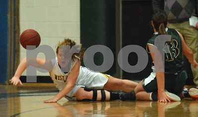 Photo by Albert J. Marro   West Rutland's Julia May, left, his the floor hard after being fouled by  MSJ's Shannon Elms during Friday's game in Westside.