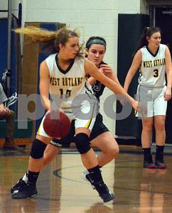 Photo by Albert J. Marro   West Rutland's Brooke Raiche (10) looks to drives on MSJ's Izzy Harvey (11) during Friday's game in Westside.