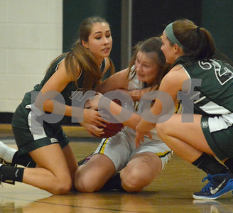 Photo by Albert J. Marro   MSJ's Jenna Eaton, left, and a Westb Rutland player battle for a loose ball during Friday's game in Westside. Bethany Garrow of the Academy is right.