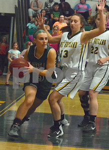 Photo by Albert J. Marro   West Rutland's Lauren Harvey (13) keeps MSJ's Gabby Giancola (5) along the baseline  during Friday's game in Westside.