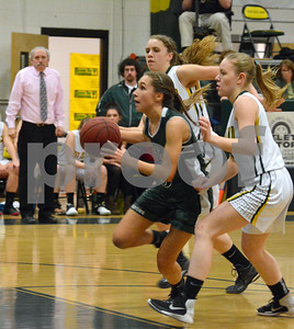 Photo by Albert J. Marro   MSJ's Jenna Eaton (3) is out in front West Rutland's Booke Raiche, back, and Shelby Grabowski during Friday's game in Westside. The Academy won 35-32.