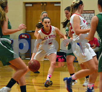 Photo by Albert J. Marro   Mill River's Olivia McPhee (15) uses a screen by teammate Tessa Davenport to drives the the land during Friday's game against Springfield in Clarendon.