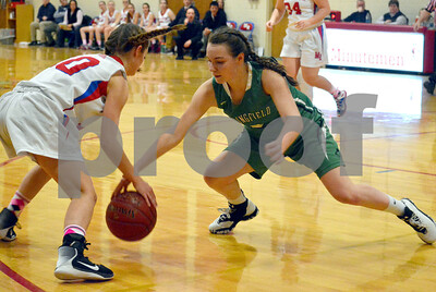 Photo by Albert J. Marro   Springfield's Halley Perham (right) strips the ball from Mill River's Emerson Pomeroy (10)  during Friday's game  in Clarendon.