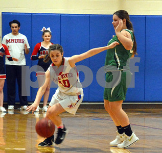 Photo by Albert J. Marro   Mill River's Emerson Pomeroy (10)drives upciourt past Springfield's Emily Therrien  during Friday's game in Clarendon.