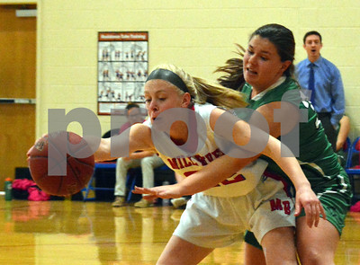 Photo by Albert J. Marro   Mill River's Melissa Fay (22) pullss in a pass despite tight coverage by Springfiel's Cassidy Otis (33) during Friday's game  in Clarendon.