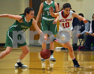Photo by Albert J. Marro   Springfield's Halley Perham, left, and Mill River's Emerson Pomeroy (10) hustle after a loos ball during Friday's game in Clarendon.