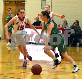 """Photo by Albert J. Marro   Lookslike basketball version of ``deflate gate"""" as Springfield's Halley Perham (0) drives upcourt during Friday's aginst Mill River in Clarendon. Defending for the Minutemen are  Olivia McPhee (15) and Melissa Fay, in back."""