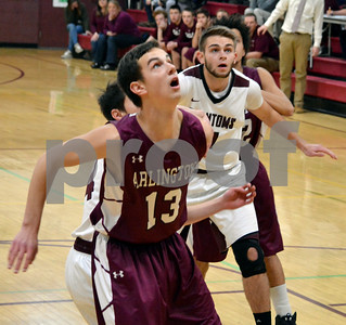 Photo by Albert J. Marro Arlington's Jacob Smith (13) and Proctor's Logan Landon, in back, look up in anticipation of a reboundduring Saturday's game in Proctor. The Phantoms won.
