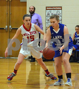 Photo by Albert J. Marro   Mill River's Olivia McPhee (15) plays tight defense  on Lake Region's Molly Horton (1) during Friday's playoff game in North Clarendon.
