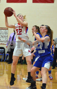 Photo by Albert J. Marro   Mill River's Melissa Fay (22) hauls in a long rebound during Friday's playoff game against Lake Region in North Clarendon. Also going for the ball is Hunter Cota (4) of the Rangers.