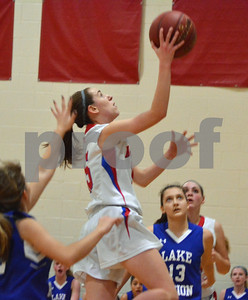 Photo by Albert J. Marro   Mill River's Olivia McPhee (15) drives down the lane during Friday's playoff game against Lakes Region in North Clarendon.