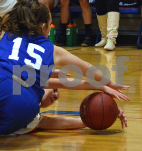 Photo by Albert J. Marro   Mill River'sEmerson Pomeroy, on floor, and  Lake Region's Natalie Racine (15) dives after a loose ball  during Friday's playoff game in North Clarendon.