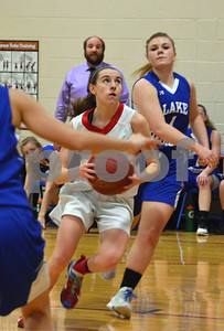 Photo by Albert J. Marro   Mill River's Olivia McPhee (15) drives down the lane on Lake Region's Molly Horton (1) during Friday's playoff game in North Clarendon.