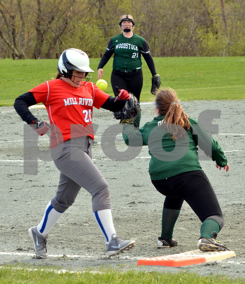 Photo by Albert J. Marro   Mill River's Grace Gilman beats ouit an infield hit during Wednesday's game against Woodstock in North Clarendon. Gilman hit a blast off the pitcher Loretta Blakeney's glove. Blakeney fielded the ball but threw a little late to firstbaseman Kennedy Moore. MRU won 5-0.
