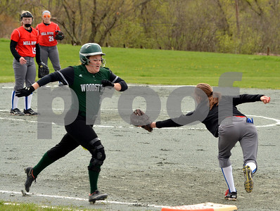 Photo by Albert J. Marro   Mill River's Sadira Majorell is pulled off the bag by a throw allowing Woodstock's Madison Shultz to be safe during Wednesday's game in North Clarendon. MRU won 5-0.