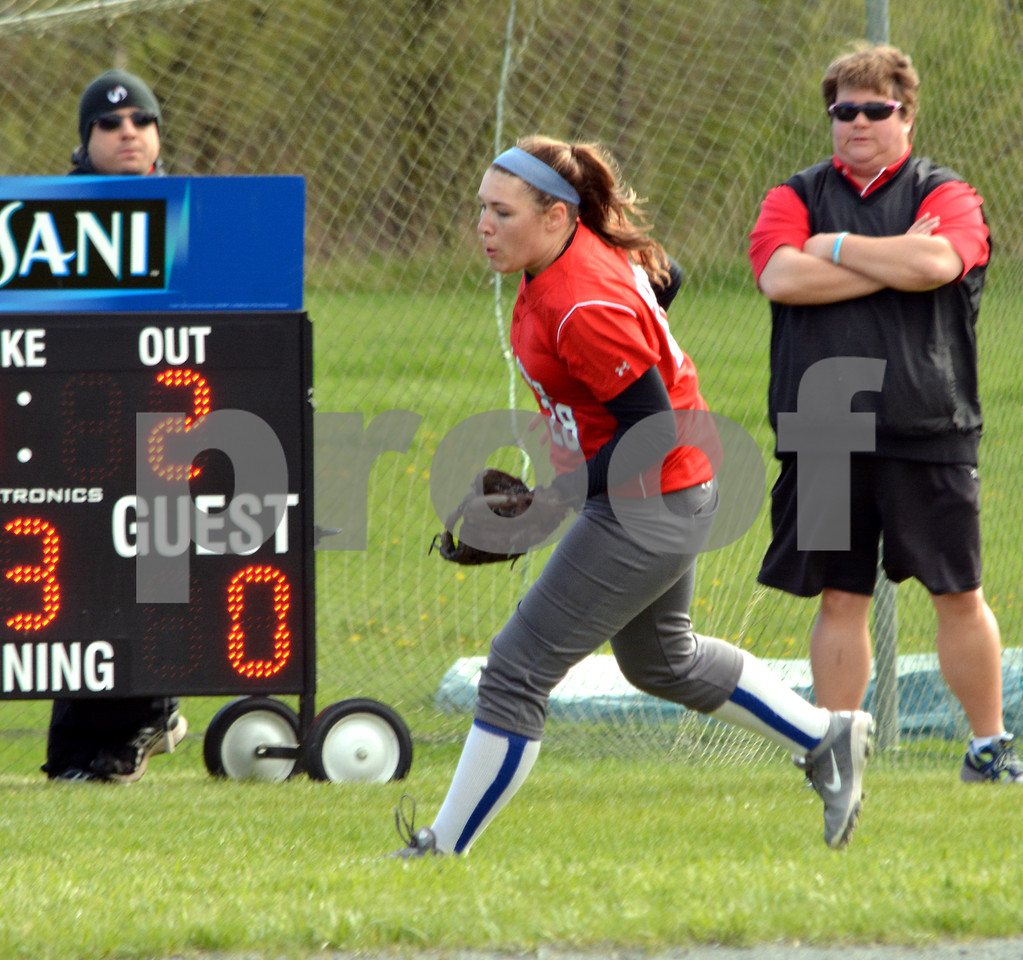 Photo by Albert J. Marro   Mill River's Grace Gilman makes a nice running catch of a little pop-up nerar the fair-foul line during Wednesday's game against Woodstock. Watching the action are team trainer Matthew Howland, left, and coach Mary Colvin. MRU won 5-0.