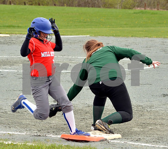 Photo by Albert J. Marro   Mill River's Caroline Blamchard beats out an infield hit during Wednesday's game against Woodstock played in North Clarendon. Kennedy Moore in the first baseman for Woodstock. MRU won 5-0.