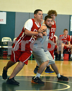 Photo by Albert J. Marro   Champlain Valley's Brian Rich (15) and Brattleboro's Cody Hellus (45) battle for position during Thursday's Unified Basketball 2017 State Championship played at Castleton University. The event is cosponsored by the Vermont Principals Association and Special Olympics of Vermont. BRattleboro won.