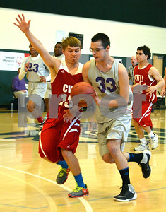 Photo by Albert J. Marro   Brattleboro's  Jacob Williams (33) drives past Champlain Valley's George Davis during Thursday's Unified Basketball 2017 State Championship played at Castleton University. The event is cosponsored by the Vermont Principals Association and Special Olympics of Vermont. BRattleboro won.
