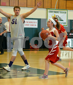 Photo by Albert J. Marro   Champlain Valley's petite Olivia Lamothe stop and pops in a basketball asBrattleboro's Taylor Patno (51) defends during Thursday's Unified Basketball 2017 State Championship played at Castleton University. The event is cosponsored by the Vermont Principals Association and Special Olympics of Vermont. BRattleboro won.