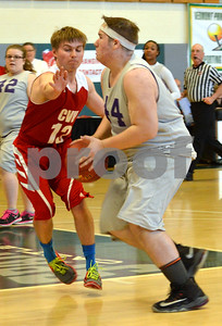 Photo by Albert J. Marro   Brattleboro's Zach Smith (44) drives to the hoop against Champlain Valley's George Davis (13) during Thursday's Unified Basketball 2017 State Championship played at Castleton University. The event is cosponsored by the Vermont Principals Association and Special Olympics of Vermont. BRattleboro won.