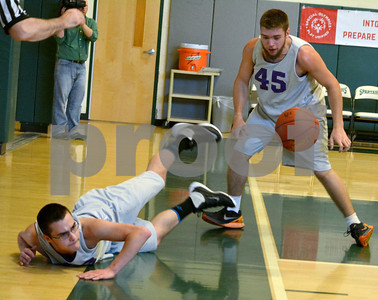 Photo by Albert J. Marro   Brattleboro's Jacob Williams, on floor, made a valiant effort to save the ball and pass it to teammate Cody Hellus (45) during Thursday's Unified Basketball 2017 State Championship played at Castleton University. Brattleboro was playing northern champion Champlain Valley. Bratt won. The event is cosponsored by the Vermont Principals Association and Special Olympics of Vermont.
