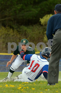 Photo by Albert J. Marro   Mill River's Jake Bishop (10) steals second sliding under the tag of MSJ's Joey Giancola. The game was played in North Clarendon.