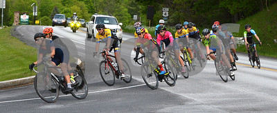 Photo by Albert J. Marro   A group of Women P/1/2/3/ riders round a corner ontp 100A  the Annual Killington Stage Race which was held over the Memorial Day weekend. Bikers from around the United State and Canada participated in the three-day event.