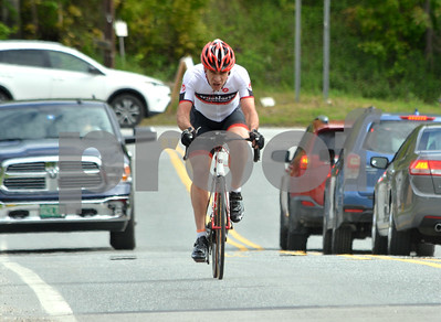 Photo by Albert J. Marro   Marc Brazeau of Gatineau, Que., works his way around traffic duirng the Master Men 4/5 race Saturday. Brazeau rode virtually alone during the entire  38 miles of the race which he won by 40 sec.Brazeau was participating in the Annual Killington Stage Race which was heals over the Memorial Day weekend. Bikers from around the United State and Canada participated in the three-day event.