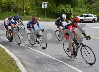Photo by Albert J. Marro The three day Killington Stage Race rolled around Rutland and Windsor Counties over the Memmorial Day weekend. Day 1 was a circuit race around Killington, Bridgewater and Plymouth.  Mark Pitts, right,  leads a group of bikers onto Rt. 100 A during the Masster Mmen 50+ race Saturday. Pitts is from North Woodstock, N.H.
