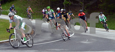 Photo by Albert J. Marro The three day Killington Stage Race rolled around Rutland and Windsor Counties over the Memmorial Day weekend. Day 1 was a circuit race around Killington, Bridgewater and Plymouth.  William Thompson, left, leads a group of bikers onto Rt. 100 A during the Masster Mmen 50+ race Saturday.