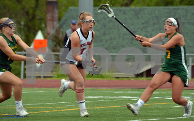 Photo by Albert J. Marro   Rutland's Marina Rotella, center, is doubled teamed by Burr & Burton's Charleigh Carthy, left, and Shayla Heekin durirng  Tuesday's playoff game at Alumni Field in Rutland.
