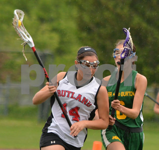 Photo by Albert J. Marro   Rutland's Francie Ettori (14) manuvers around Burr & Burton's Grace Petty during  Tuesday's playoff game at Alumni Field in Rutland.