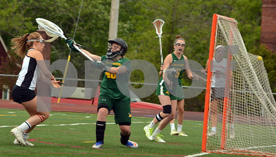 Photo by Albert J. Marro   Rutland's Marina Rotella, left,burst through the Burr & Burton defense to score early in Tuesday's playoff game at Alumni Field in Rutland. Cassie Pearce is the goalie for the Bulldogs.