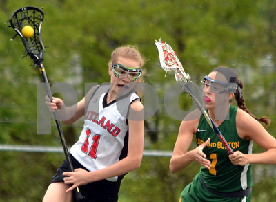 Photo by Albert J. Marro   Rutland's Caitlin French (11) attempts to move the ball around Burr & Burton's Fiona McMahon during  Tuesday's playoff game at Alumni Field in Rutland.