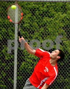 Photo by Albert J. Marro  Rutland's Connor Solimano servest during Friday's playoff match against Nick Schramm of Colchester.