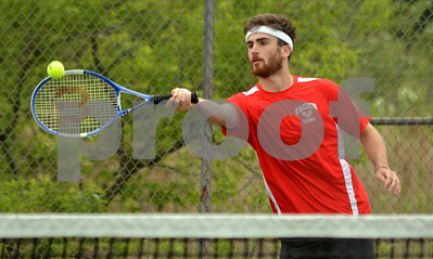 Photo by Albert J. Marro  Rutland's Keegan Bliss  returns a shot during Friday's first doubles playoff match against Ethan Dean and Andrew St. Pierre of Colchester. Bliss was teamed withj John Michel.