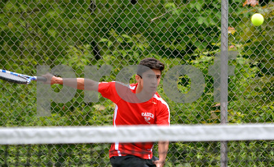 Photo by Albert J. Marro  Rutland's Andres Aguilar returns a shot during Friday's playoff match against Brendan Adamczyk of Colchester.