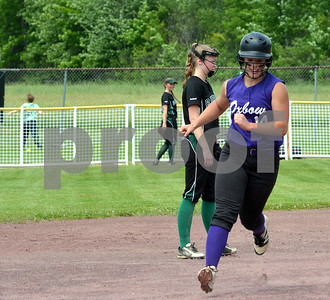 Photo by Albert J. Marro Oxbow's Madison Fornwalt is in her home trun trost after smacking her second blast over the right-center field fence (ball in background) during the D-III softball championship game against Leland & Gray.  Oxbow defeated Leland & Gary 11-2 at Veterans Park in Poultney Saturday afternoon.