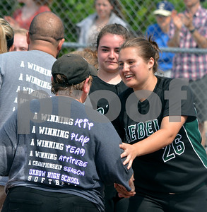 Photo by Albert J. Marro Oxbow coach Robin Wozny, left, is warmly congratulated by Leland & KLray's Rachel Borgsen after Wozny's Olympians won the D-III softball championship . Oxbow defeated Leland & Gary 11-2 at Veterans Park in Poultney Saturday afternoon.