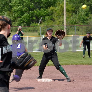 Photo by Albert J. Marro Oxbow's Alex Giesling (7) scampers safely back to second   during the D-III softball championship game against Leland & Gray. Jessica Madore (9) waits for the throw for the Rebels  Oxbow defeated Leland & Gary 11-2 at Veterans Park in Poultney Saturday afternoon.