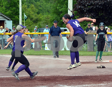 Photo by Albert J. Marro Oxbow relief pitcher Madison Fornwalt leaps in the air starting the celebration for the Olympians as the D-III softball champions. Oxbow defeated Leland & Gary 11-2at Veterans Park in Poultney Saturday afternoon.