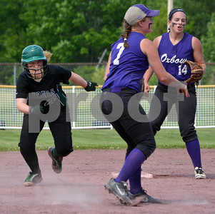 Photo by Albert J. Marro Leland & Gray's Jessica Stockwell, left, looks to advance to third during the D-III softball championship game against Oxbow. Alex Giesing (7)  threw outs a Rebel runner at first.  Oxbow defeated Leland & Gary 11-2 at Veterans Park in Poultney Saturday afternoon.