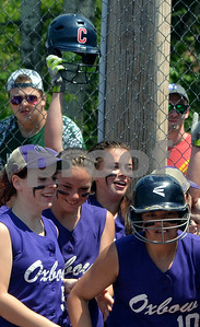 Photo by Albert J. Marro Oxbow's Mary Bourgeois, in back, raies her helmet after hitting as home run  during the D-III softball championship game against Leland & Gray.   Oxbow defeated Leland & Gary 11-2 at Veterans Park in Poultney Saturday afternoon.
